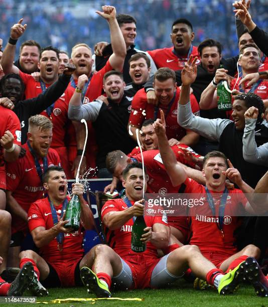 Champions Saracens celebrate with the trophy and Champagne after the Champions Cup Final match between Saracens and Leinster at St. James Park on May...