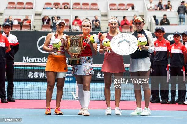 Champions Sofia Kenin and Bethanie MattekSands of the United States runnerups Dayana Yastremska of Ukraine and Jelena Ostapenko of Latvia pose with...