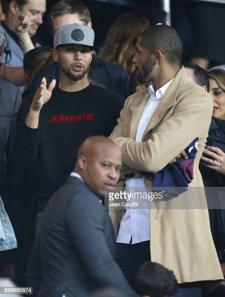 NBA champions Stephen Curry of Golden State Warriors and Nicolas Batum of Charlotte Hornets attend the French Ligue 1 match between Paris Saint...