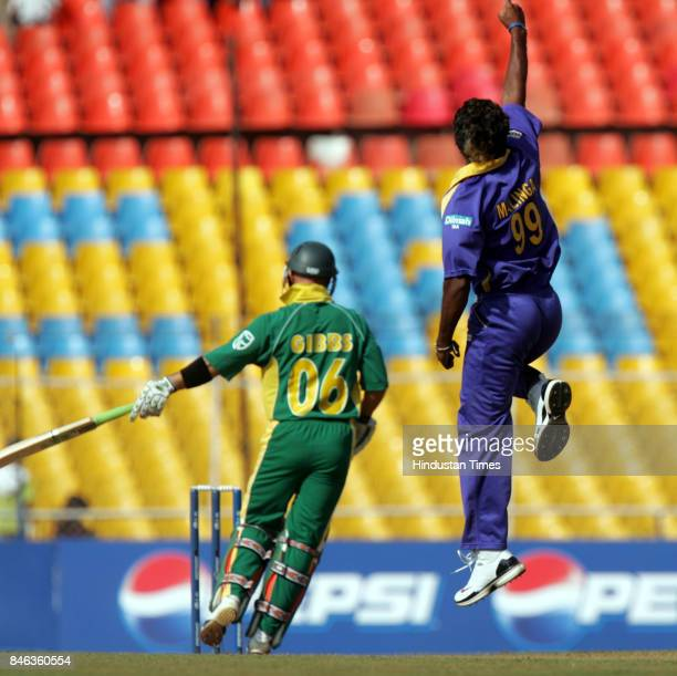 Sri Lankas bowler Lasith Malinga celebrates after the dismissal of South African Herschelle Gibbs in the ICC Champions Trophy at the Sardar Patel...