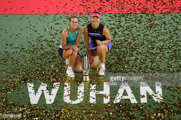 Champions Veronika Kudermetova of Russia and Duan Yingying of China pose with their trophy after the doubles final match against Elise Mertens of...