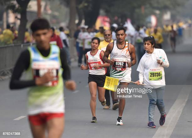 Champions with disability take part during the Airtel Delhi Half Marathon 2017 at JLN Stadium on November 19 2017 in New Delhi India Thousands of...
