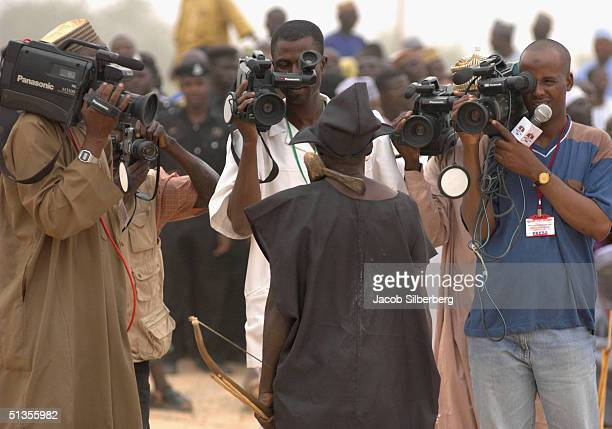 A championship archer stands before local media cameras on March 17 2004 at the Argungu Fishing Festival in Argungu Nigeria The Argungu Fishing...