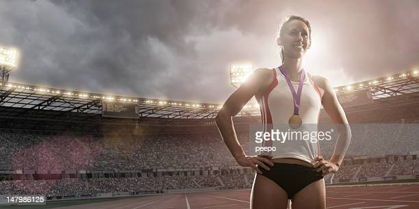 championship athlete gold medal winner - arms akimbo stock pictures, royalty-free photos & images