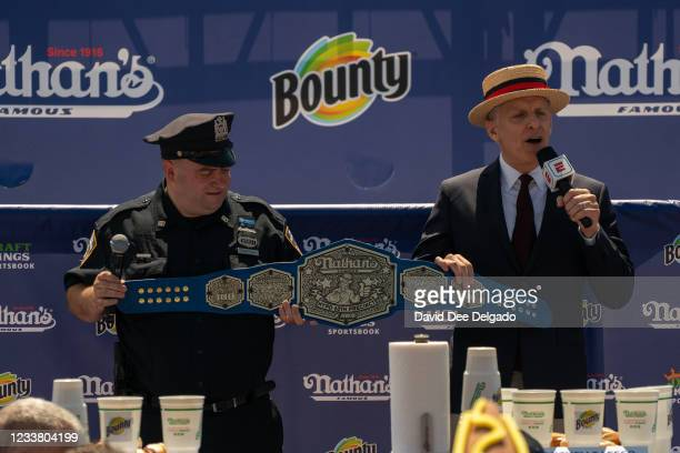 Championship belt was presented to the officers of the 60th precinct at the 2021 Nathan's Famous 4th Of July International Hot Dog Eating Contest at...