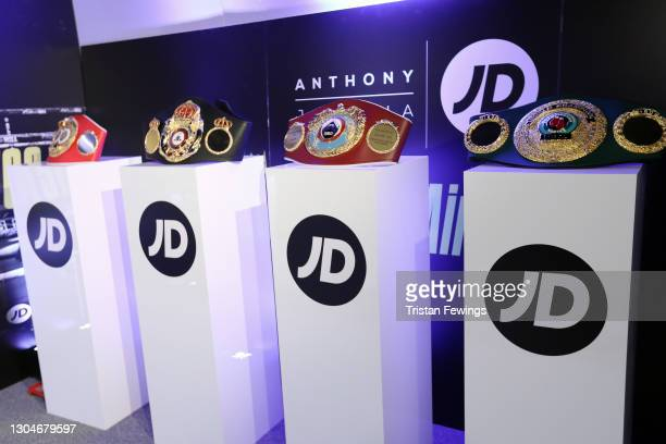 Championship belts are displayed as JD's Anthony Joshua hosts his #KingOfTheAirwaves radio show live on TikTok with a host of special guests...