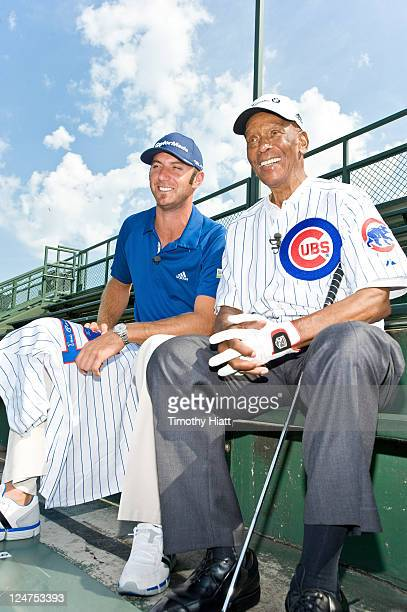 Championship defending champion Dustin Johnson and Cubs legend Ernie Banks talk golf at Wrigley Field after competing in a historic challenge in...