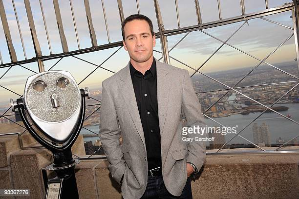 NASCAR championship driver Jimmie Johnson poses for pictures on the Empire State Building Observation Deck in celebration of Jimmie Johnson Day on...