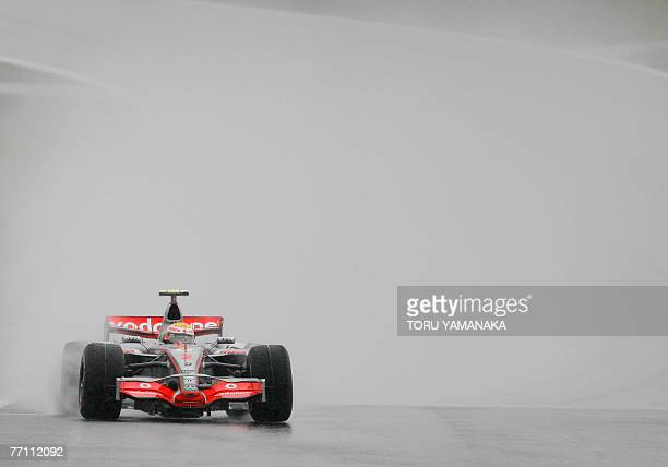 Championship point leader Lewis Hamilton of Britain speeds his McLaren-Mercedes in the rain in the Formula One Japanese Grand Prix at the Fuji...