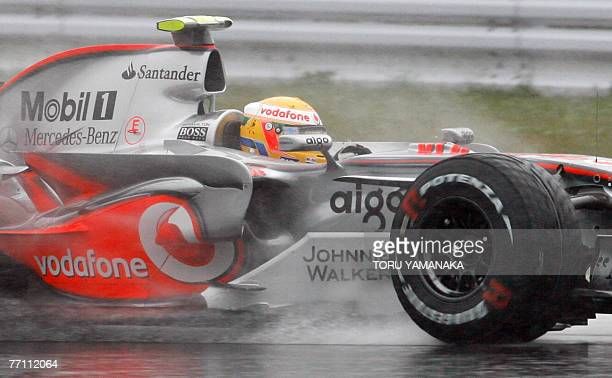 Championship point leader Lewis Hamilton of Britain speeds his McLaren-Mercedes under the rain in the Formula One Japanese Grand Prix at the Fuji...