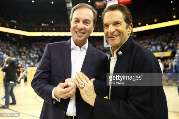 2017 NBA Championship rings are seen on the hands of team owners Joe Lacob and Peter Guber during their NBA game at ORACLE Arena on October 17 2017...