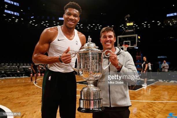 Championship Winner Brooks Koepka poses for a photo with Giannis Antetokounmpo of the Milwaukee at Barclays Center on February 4 2019 in Brooklyn New...