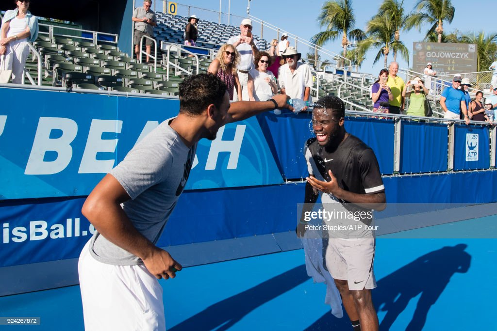 Championship winner Frances Tiafoe of United States gets a soaking from assistant coach Zack Evenden and physiotherapist Paul Kinney after his match with Peter Gojowczyk of Germany at the Delray Beach Open held at the Delray Beach Stadium & Tennis Center on February 25, 2018 in Delray Beach, Florida