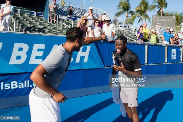 Championship winner Frances Tiafoe of United States gets a soaking from assistant coach Zack Evenden and physiotherapist Paul Kinney after his match...