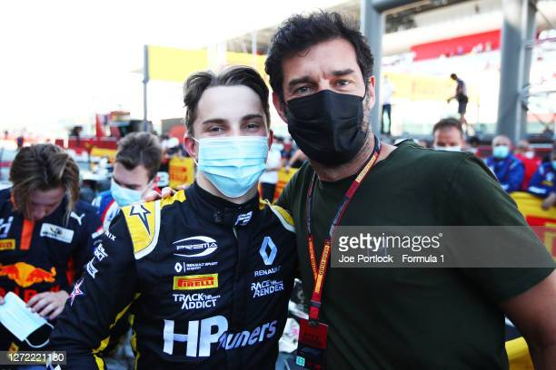 Championship winner Oscar Piastri of Australia and Prema Racing poses for a photo with former F1 driver Mark Webber in parc ferme during the Formula...