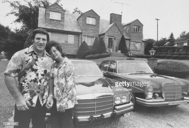 Championship wrestler Bruno Sammartino standing with his wife in front of their home.