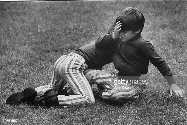 Championship wrestler Bruno Sammartino's children playing on the lawn of their home.