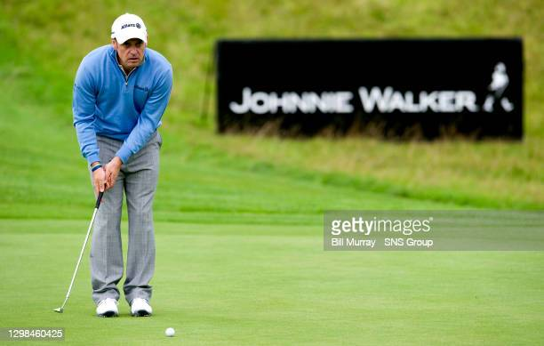 Paul McGinley watches on as putts on the green