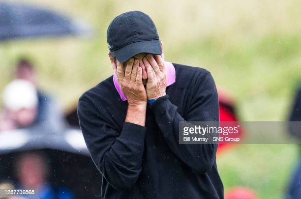 Spain's Jose Maria Olazabal hangs his head on the 10th green.