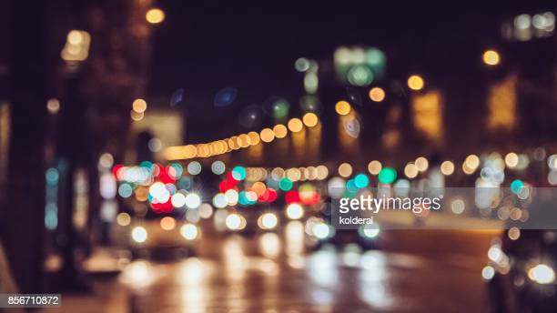 champs elysees avenue night traffic bokeh