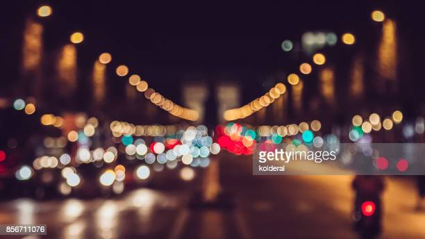 champs elysees avenue night traffic bokeh