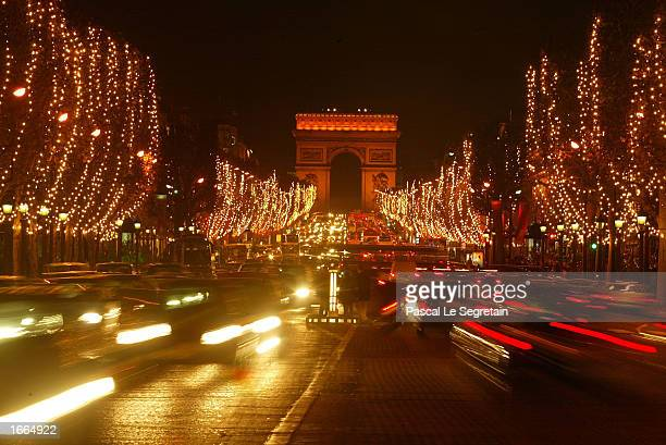 ChampsElysees Avenue lights up in preparations for the upcoming Christmas holiday season November 28 2002 in Paris