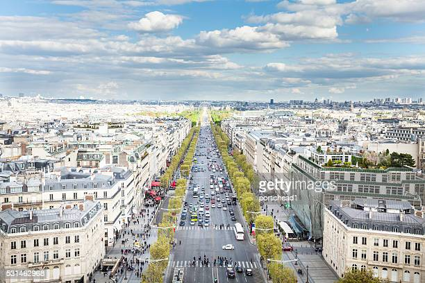 champs-élysées avenue, seen from the top of arc de triomphe - champs elysees quarter stock pictures, royalty-free photos & images
