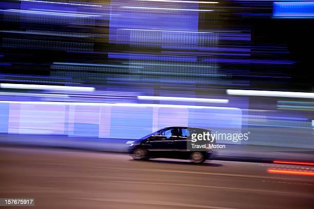 Champs-Élysées traffic with panning motion at night, Paris, France