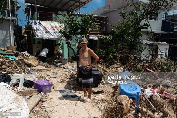 Chan a resident of Shek O beach poses for a photo after ane interview with AFP in the aftermath of super Typhoon Mangkhut in Hong Kong on September...