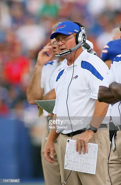 Chan Gailey head coach of the Buffalo Bills stands on the sidelines against the Jacksonville Jaguars at Ralph Wilson Stadium on August 27 2011 in...
