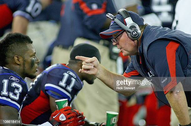 Chan Gailey head coach of the Buffalo Bills talks to Steve Johnson on the sidelines against the Chicago Bears at Rogers Centre on November 7 2010 in...