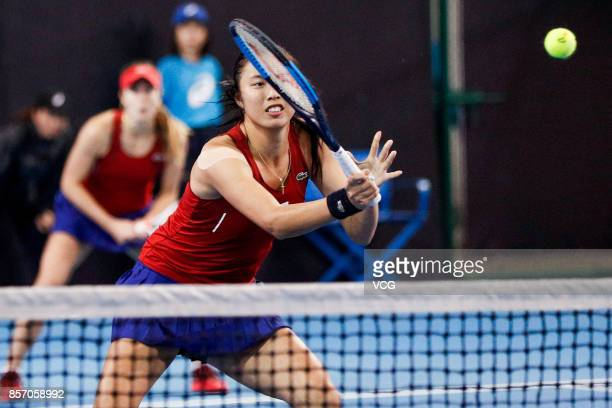 Chan Haoching of Chinese Taipei and Alize Cornet of France compete during the Women's doubles first round match against Makoto Ninomiya of Japan and...