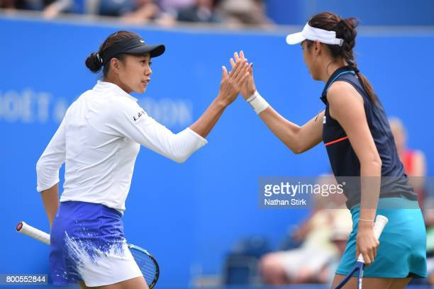 Chan HaoChing of Taiwan and Zhang Shuai of China high five each other during the semi final doubles match against Raquel Atawo and Christina Mchale...