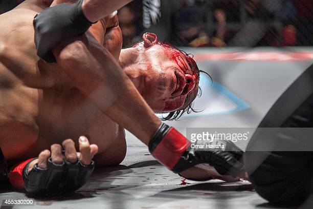 Chan Heng lays bleeding on the floor of the cage after being knockedout by Meas Meu during One FC Cambodia on September 12 2014 in Phnom Penh Cambodia