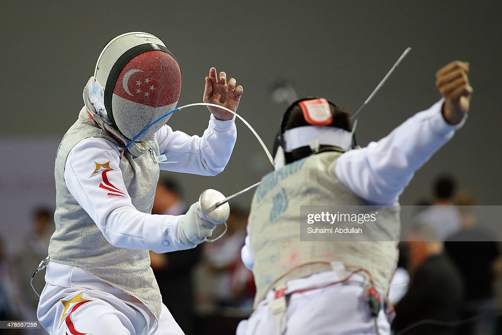 Chan Kevin Jerrold of Singapore (L) and Alireza Adhami of Iran compete in the men's individual foil pool event during the 2015 Asian Fencing Championships at OCBC Arena on June 26, 2015 in Singapore.