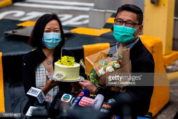 Chan Kin-man , co-founder of Occupy Central and pro-democracy activist, holds up a birthday cake with his wife after he was released from Pik Uk...