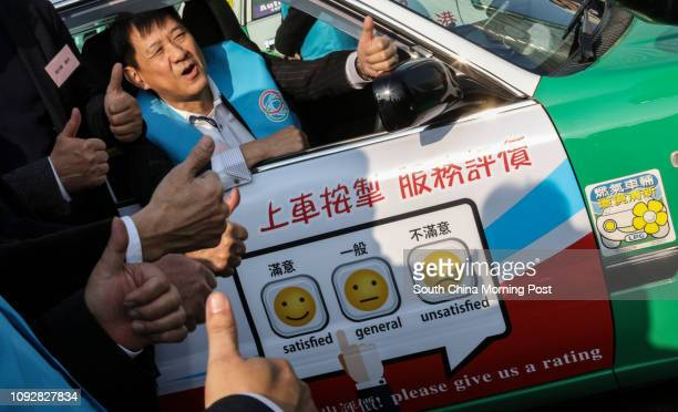 Chan Mankeung President of The Association For Taxi Industry Development shows the newly implemented driver rating gadget in Tsim Sha Tsui 28FEB17...