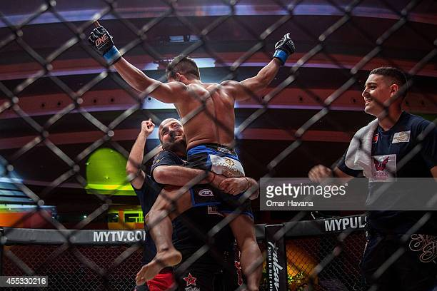 Chan Rothana celebrates his victory after defeating Prak Chansin during One FC Cambodia on September 12 2014 in Phnom Penh Cambodia