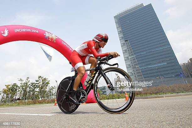 Chan Siew Kheng Dinah of Singapore of Singapore rides in the women's individual time trial on day eight of the 2014 Asian Games at Songdo Road...