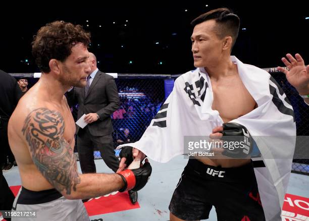 Chan Sung Jung of South Korea and Frankie Edgar shake hands after their featherweight fight during the UFC Fight Night event at Sajik Arena 3 on...