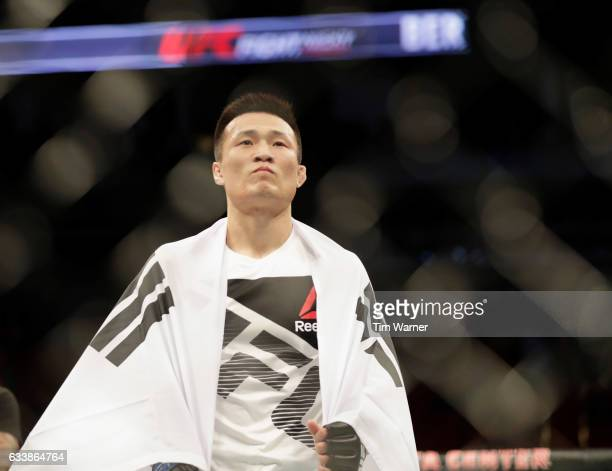 Chan Sung Jung of South Korea celebrates after defeating Dennis Bermudez in their featherweight bout during the UFC Fight Night event at the Toyota...