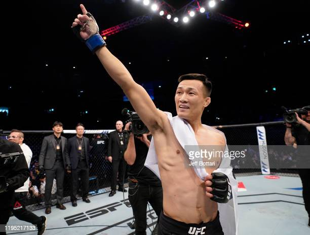 Chan Sung Jung of South Korea celebrates after knocking out Frankie Edgar in their featherweight fight during the UFC Fight Night event at Sajik...