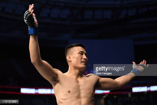 Chan Sung Jung of South Korea celebrates his KO victory over Renato Moicano of Brazil in their featherweight bout during the UFC Fight Night event at...