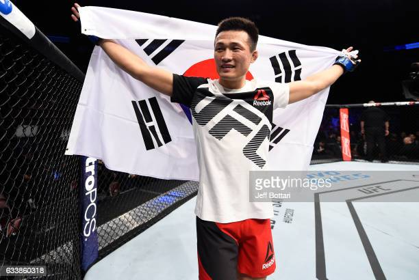 Chan Sung Jung of South Korea celebrates his victory over Dennis Bermudez in their featherweight bout during the UFC Fight Night event at the Toyota...