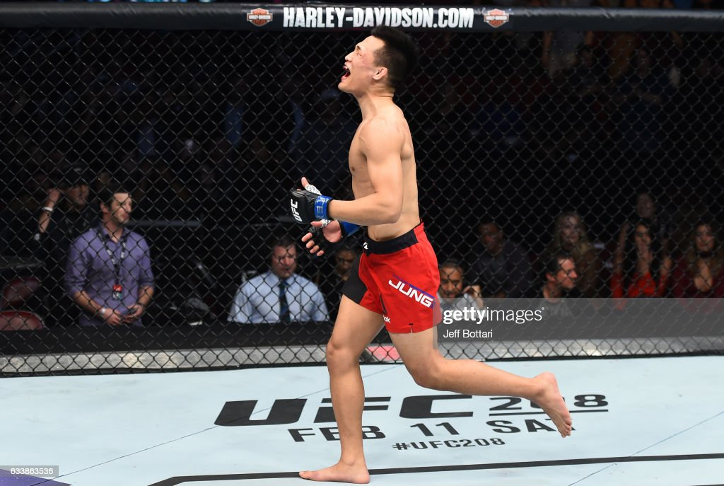 Chan Sung Jung of South Korea celebrates his victory over Dennis Bermudez in their featherweight bout during the UFC Fight Night event at the Toyota Center on February 4, 2017 in Houston, Texas.