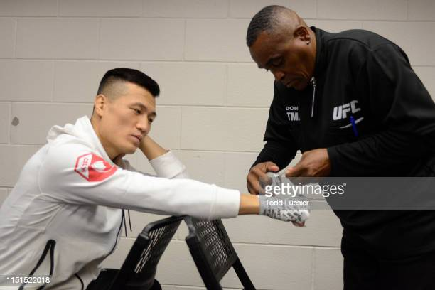 Chan Sung Jung of South Korea has his hands wrapped backstage during the UFC Fight Night event at Bon Secours Wellness Arena on June 22 2019 in...