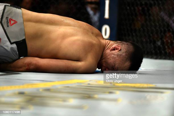 Chan Sung Jung of South Korea lies on the Octagon mat after being knocked out by Yair Rodriguez of Mexico in their featherweight bout during the UFC...