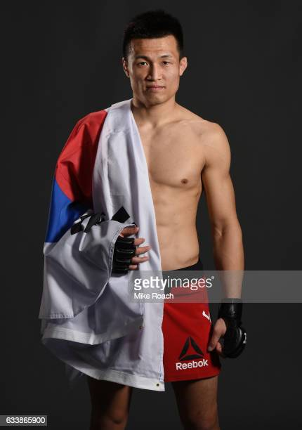 Chan Sung Jung of South Korea poses for a picture backstage with Raquel Pennington during the UFC Fight Night event at the Toyota Center on February...