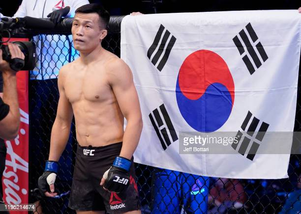 Chan Sung Jung of South Korea prepares to fight Frankie Edgar in their featherweight fight during the UFC Fight Night event at Sajik Arena 3 on...