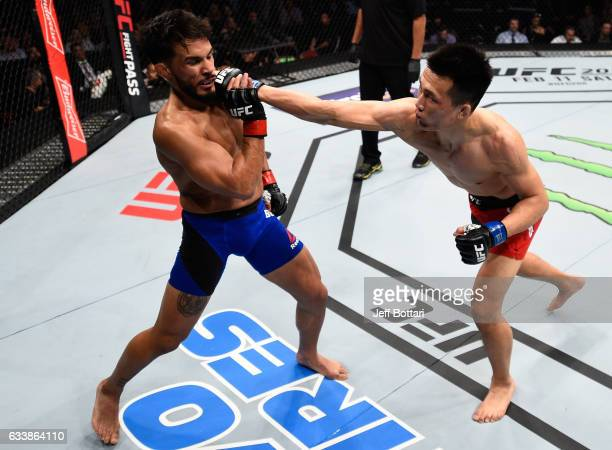 Chan Sung Jung of South Korea punches Dennis Bermudez in their featherweight bout during the UFC Fight Night event at the Toyota Center on February 4...